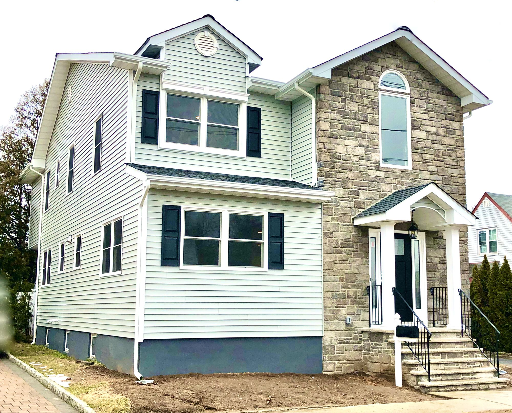 House Renovation and Addition with GAF Roofing, Alside Conquest Siding, Andersen Windows, Portico with Boral Cultured Stone Veneers in Fairlawn, Bergen County NJ