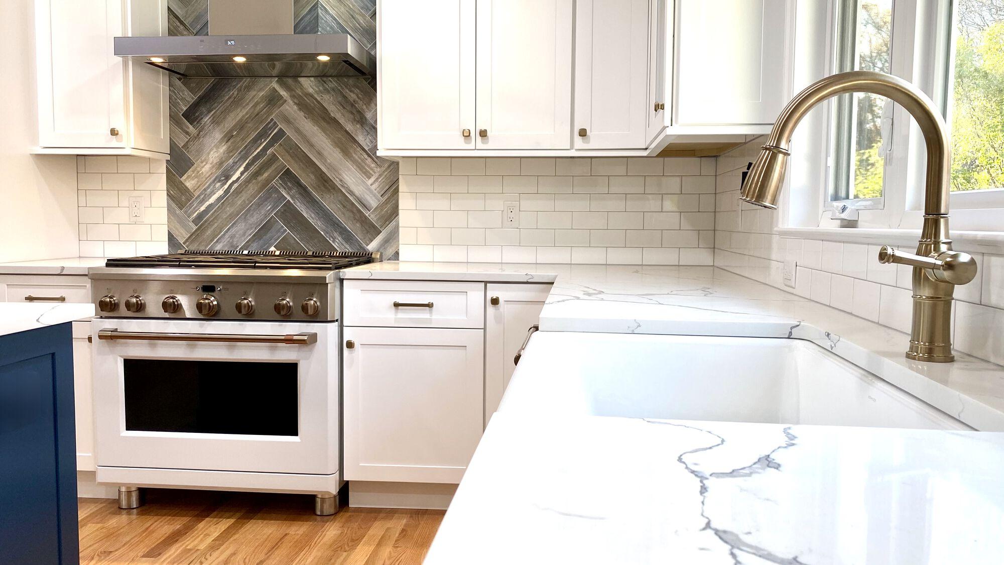 Shaker Full Overlay Wood Cabinetry, Subway and Herringbone Splash, Kohler Fixtures, GE Cafe Appliances in Berkeley Heights, Union County NJ