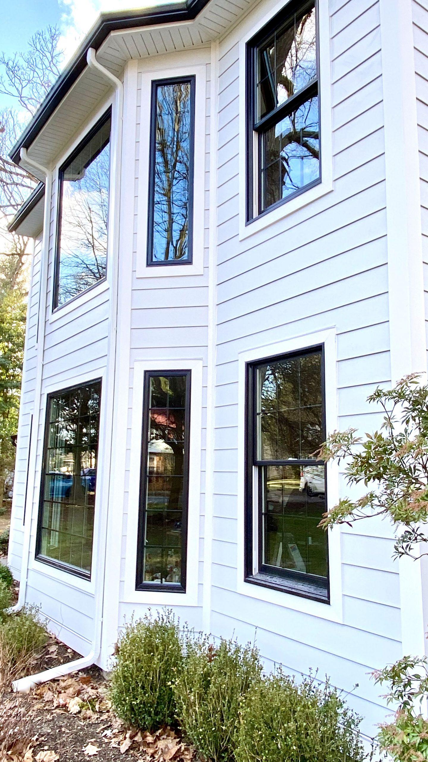 HardiePlank Smooth Clapboard Arctic White Siding, Charter Oak Soffit, Black Gutters and Leaders, Andersen 400 Series Windows in Ramsey, Bergen County NJ