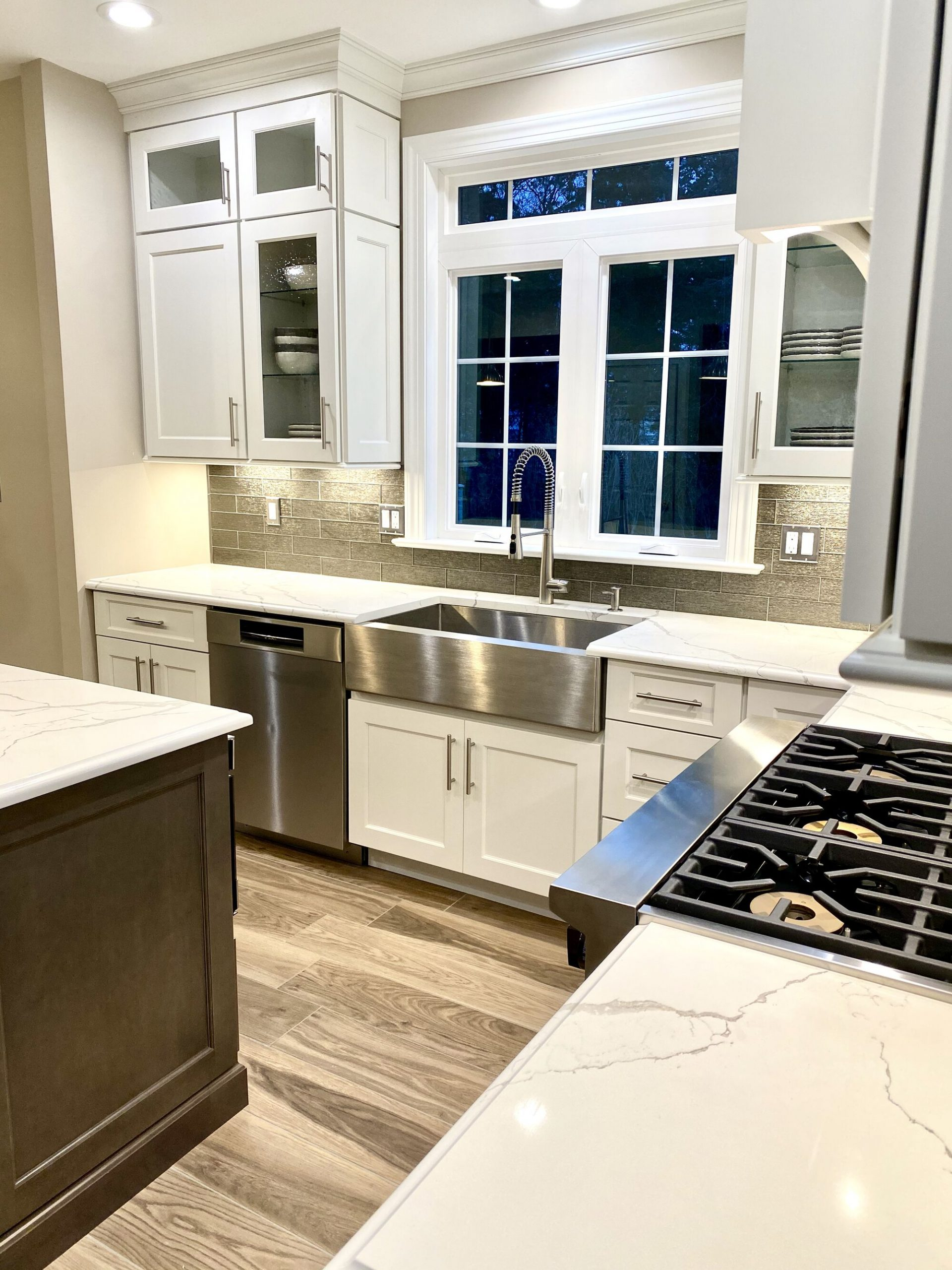 Large Window and Transom over Sink, Stainless Stel Farmhouse Sink, Custom Wood Cabinetry, Viking Appliances in Somerset NJ