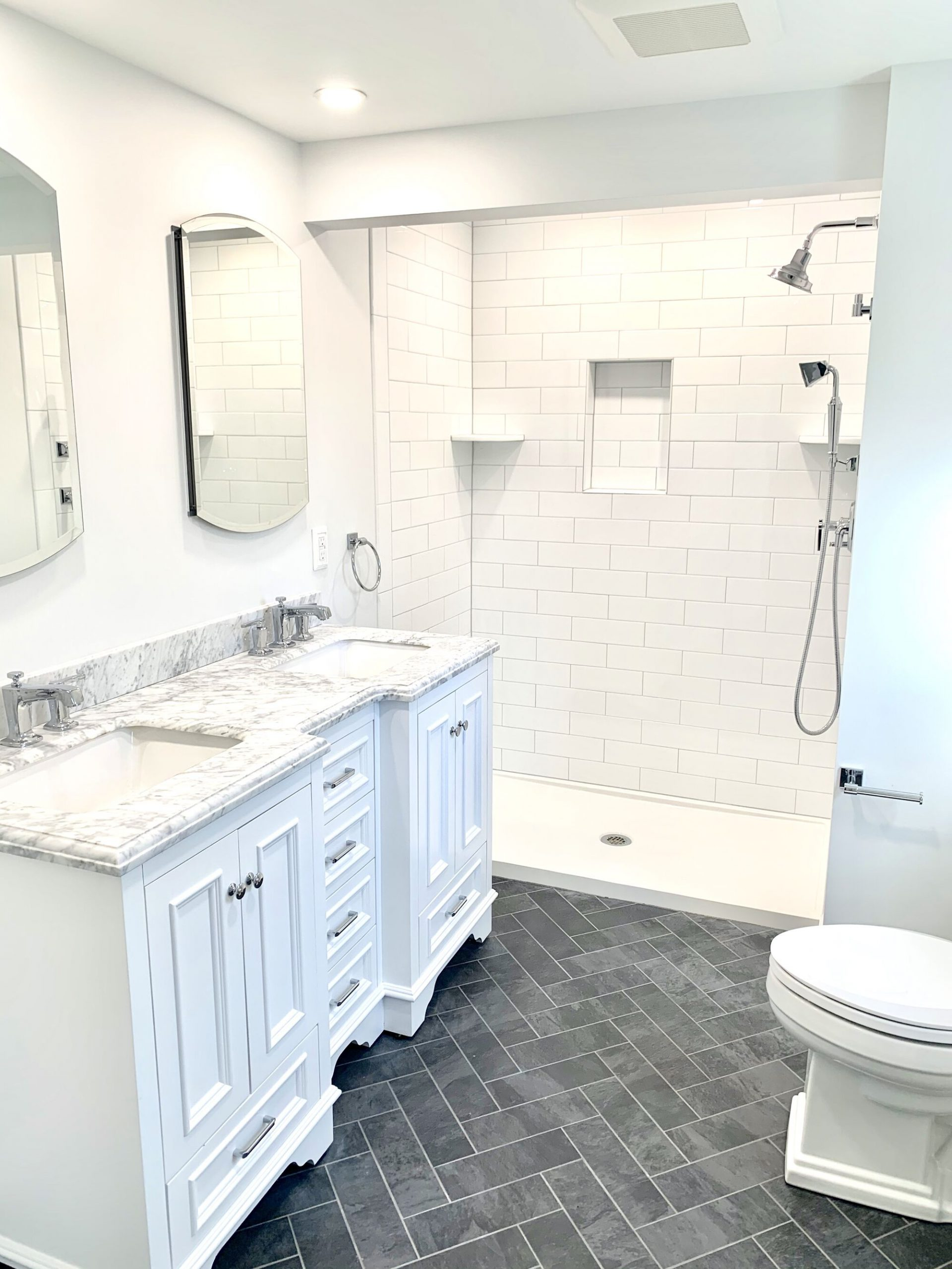 Fixture Bath with Wood Vanity and Marble Top, Subway Tiled Shower Wall in West Caldwell, Essex County NJ
