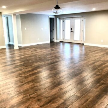 Basement Remodeling with Walk Out Doors, Laminate Flooring, Bath and Laundry in Little Falls, Essex County NJ