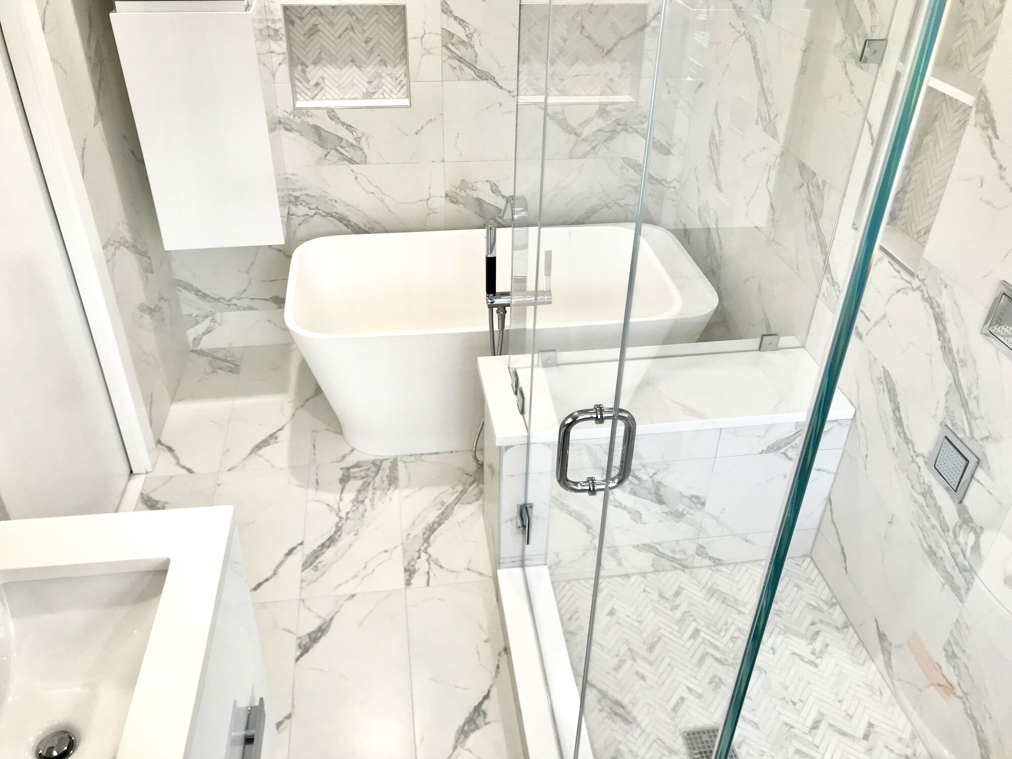 Freestanding Tub, Custom Shower _ Bench, Tile Walls in a compact bathroom in Maplewood, Essex County NJ