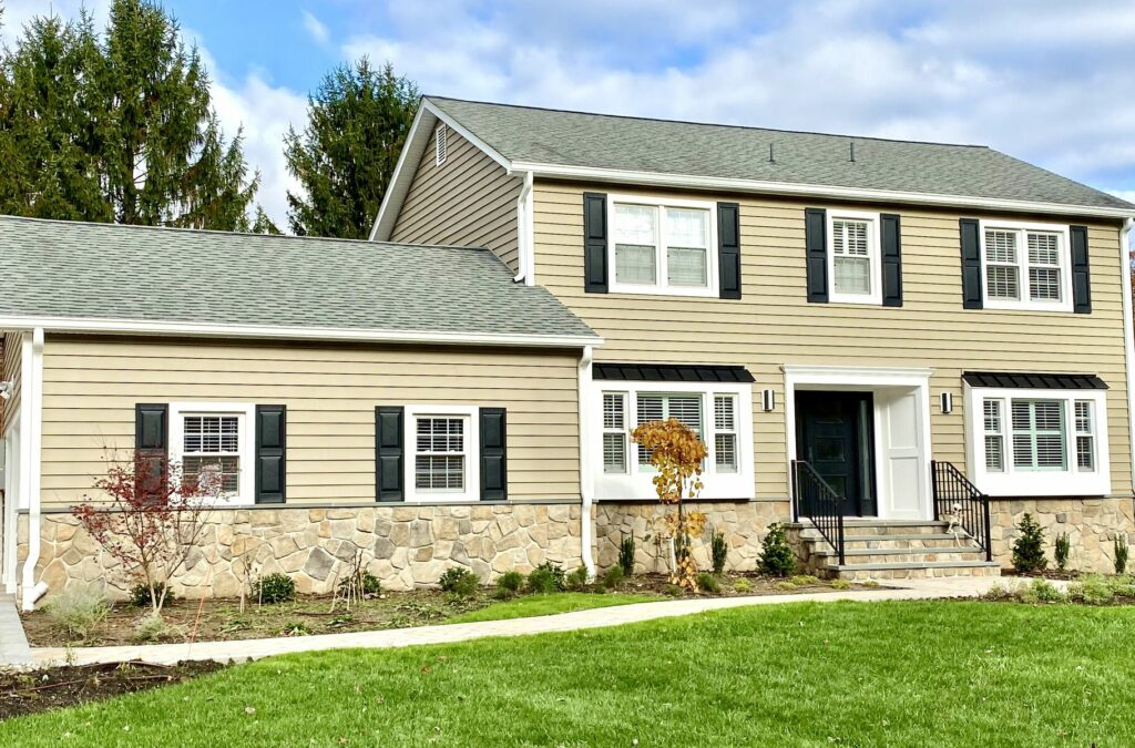 Prodigy Siding Tuscan Clay, Boral Dressed Fieldstone, Black Metal Roofing, Azek Trim, Therma Tru Front Door, Cambridge Pavers Walkway and Driveway in Randolph, Morris County NJ