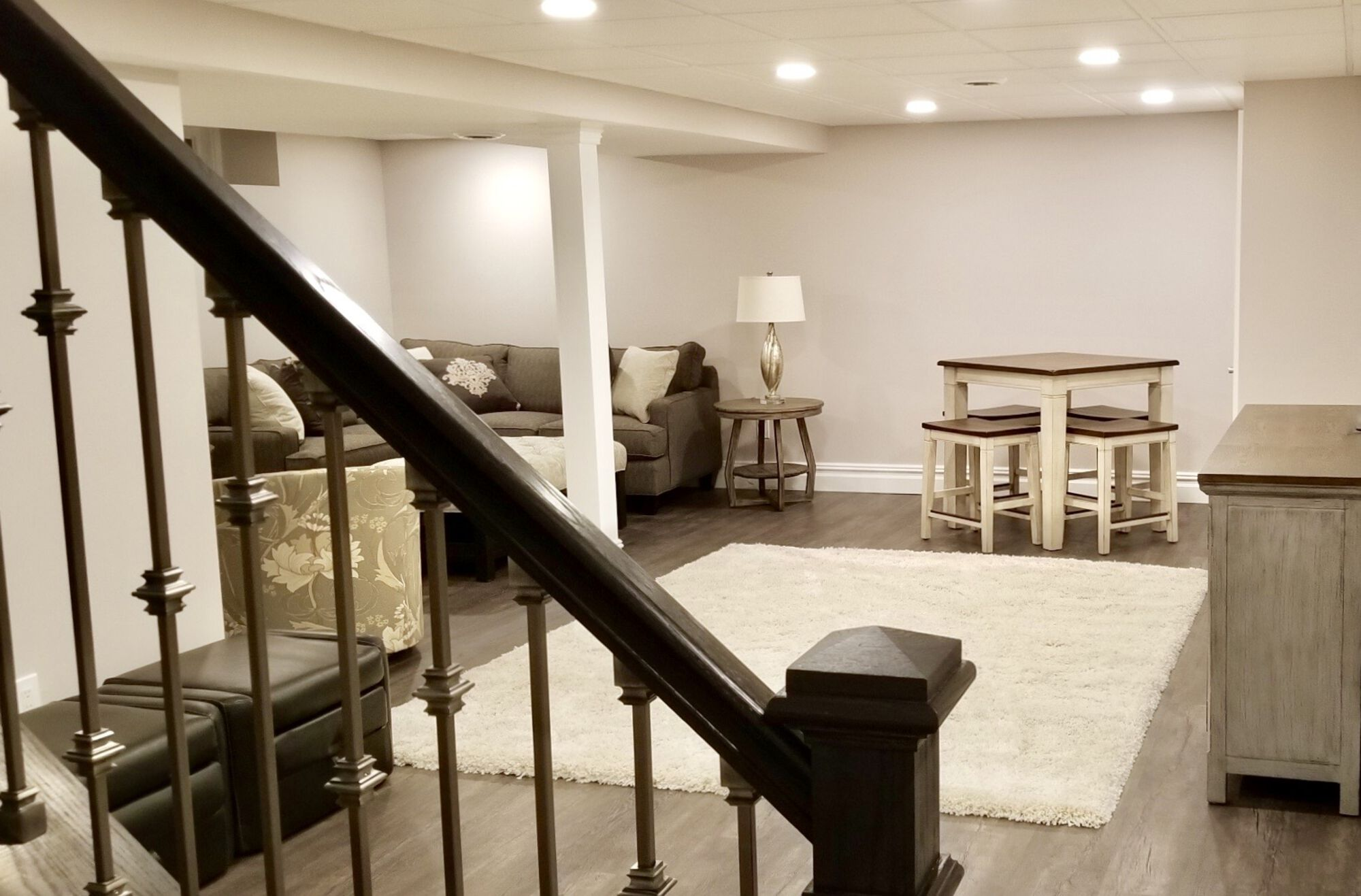 Basement with Mold and Mildew Resistant Drywall, Vinyl Plank Flooring, Acoustic Ceiling, Wood and Metal Rail, LED Lighting In East Brunswick, Middlesex County NJ