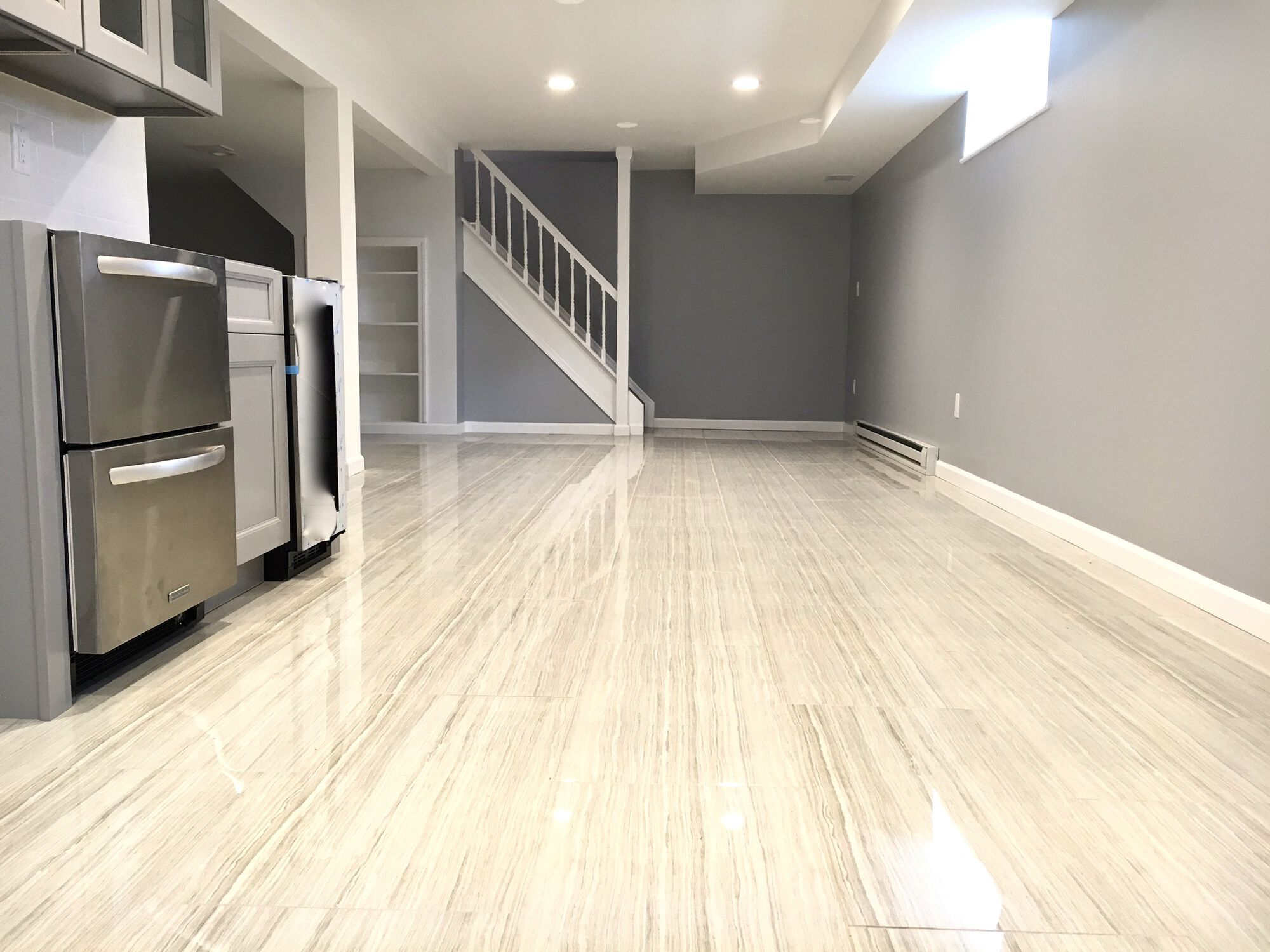 Basement Remodeling with Porcelain Tile Flooring, Kitchenette and Built In Storage in Clifton, Passaic County NJ