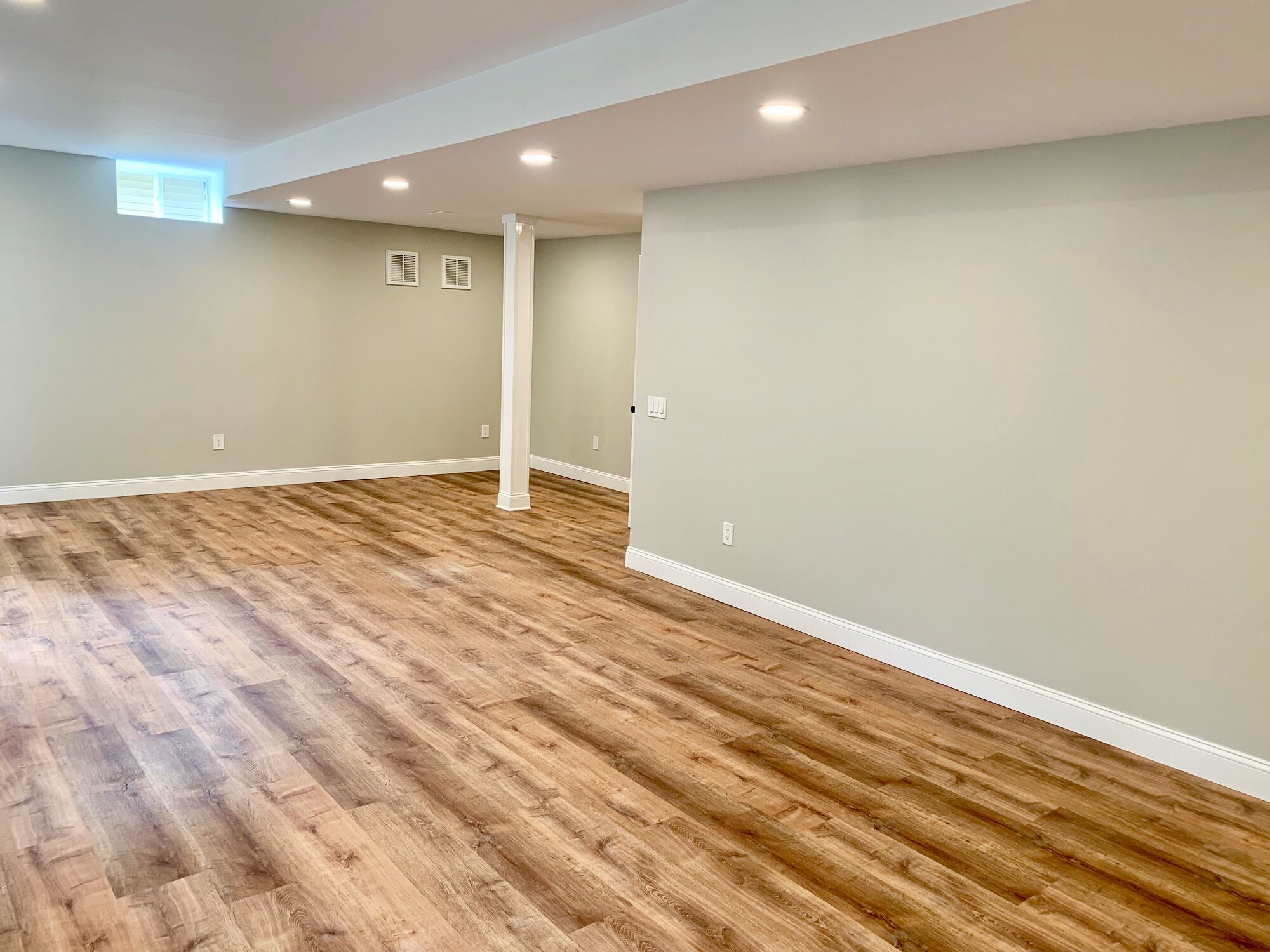Finished Basement with Mold and Mildew Resistant Purple Drywall, MDF Trim, Vinyl Flooring, Heating and Cooling System, Full Bath in West Orange, Essex County NJ