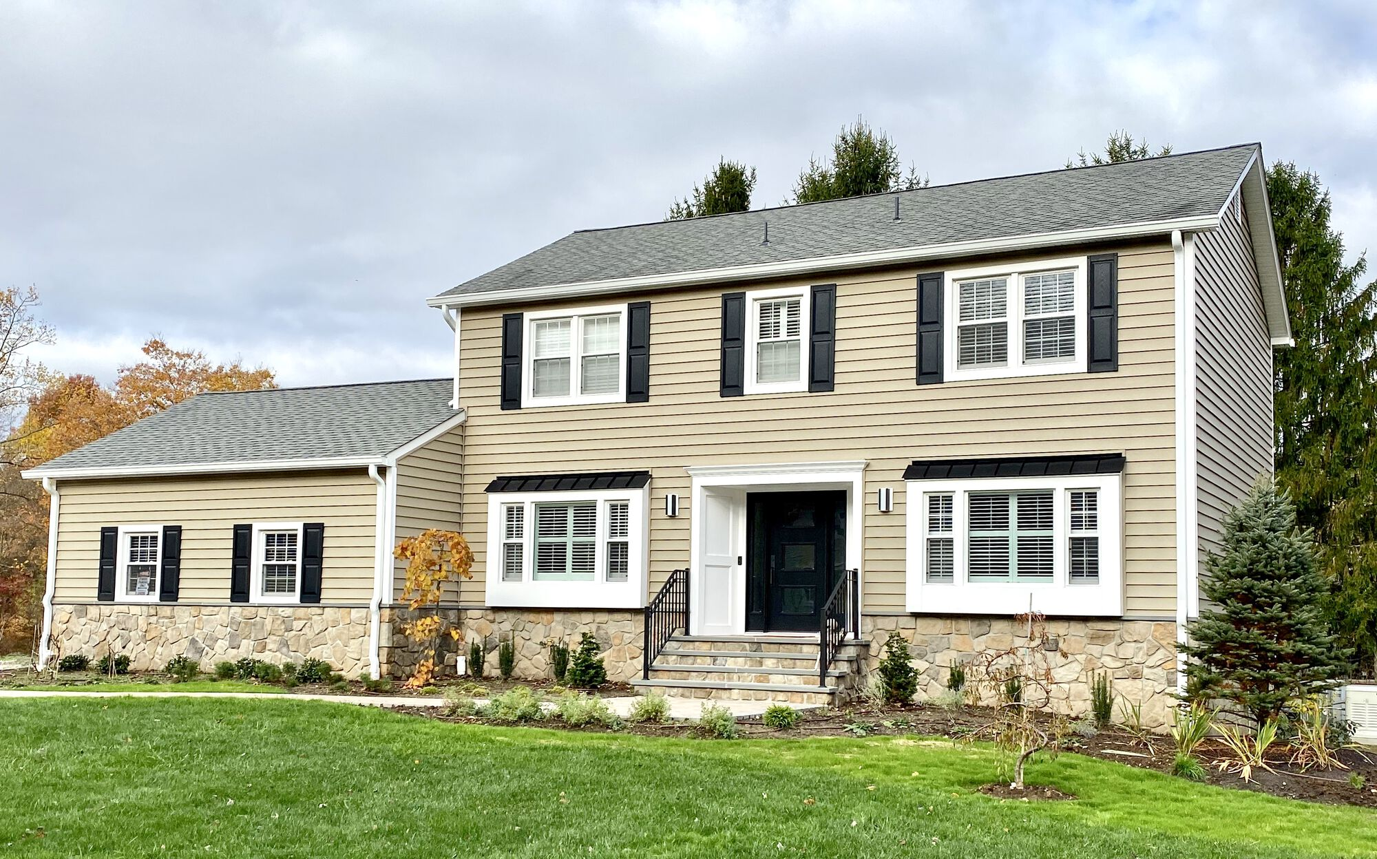Alside Prodigy Clapboard Siding with Cultured Stone Veneer to Foundation and Steps in Randolph, Morris County NJ