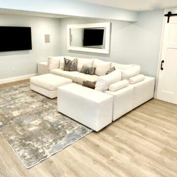 Basement Remodeling with Barn Door, Laminate Vinyl Plank Flooring in Sparta, North Jersey