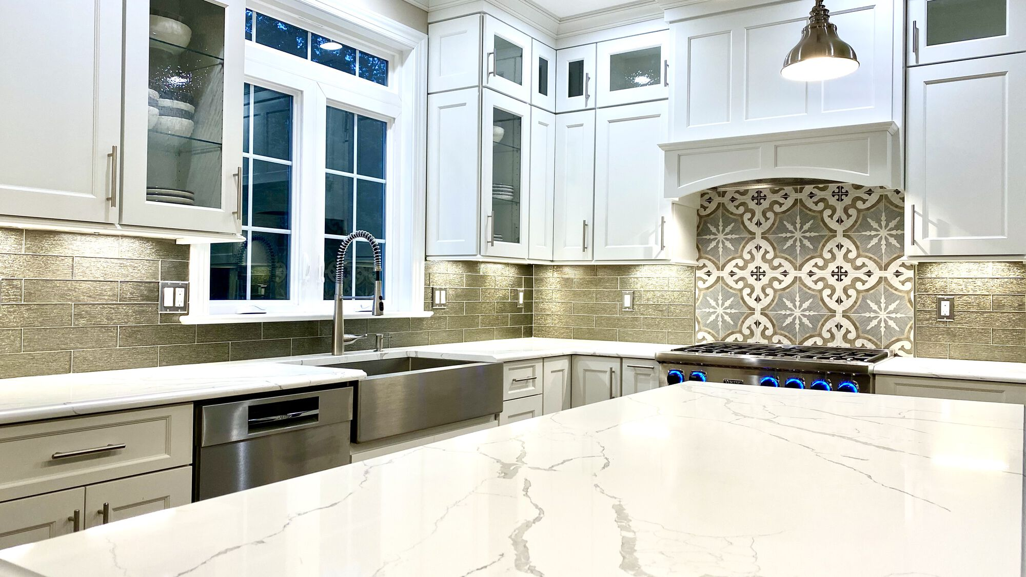 Brighton Cabinetry with Quarts Tops, Glass and Porcelain Tile Backsplash, LED In Cabinet and Under cabinet Lighting, Viking Appliances in Somerset County NJ