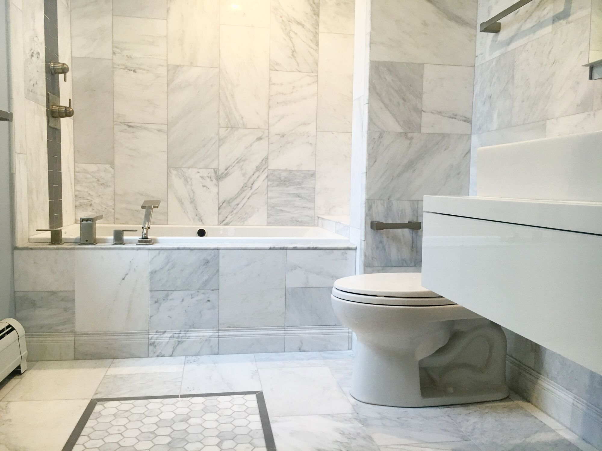 Marble Master Bath with Drop In Tub, Deck Mounted Tub Faucet, Floating Vanity in Fort Lee, Hudson County NJ