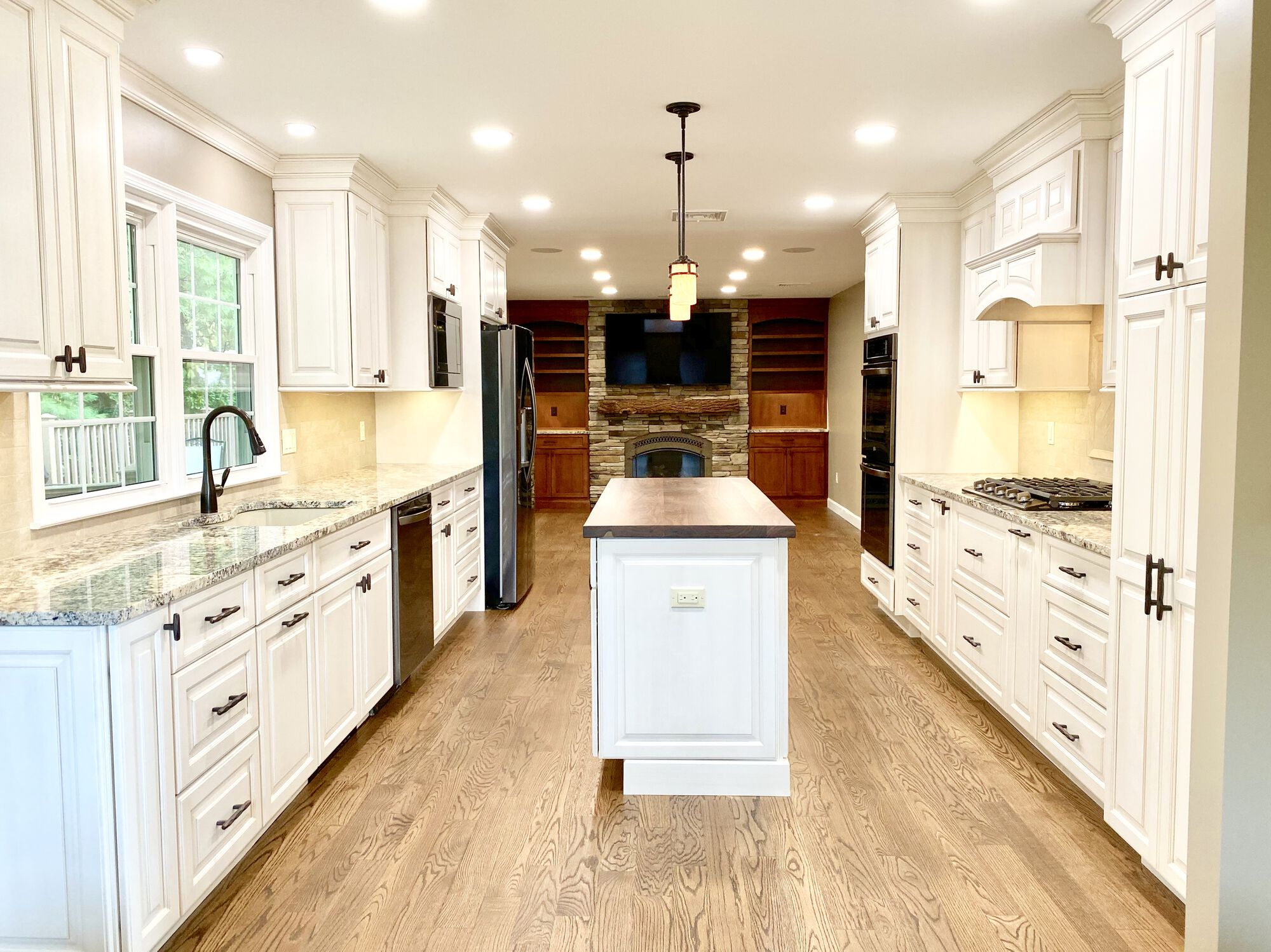 Brighton Cabinetry for Kitchen and Fireplace Wall, Oak Flooring, Walnut Wood Countertop in Rockaway, Morris County NJ