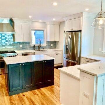 White Shaker Cabinets, Blue Glass Tile Backsplash, Island and 2 Tier Bar Height Counter, Wood Flooring and Stone Tops in Bergen County, NJ