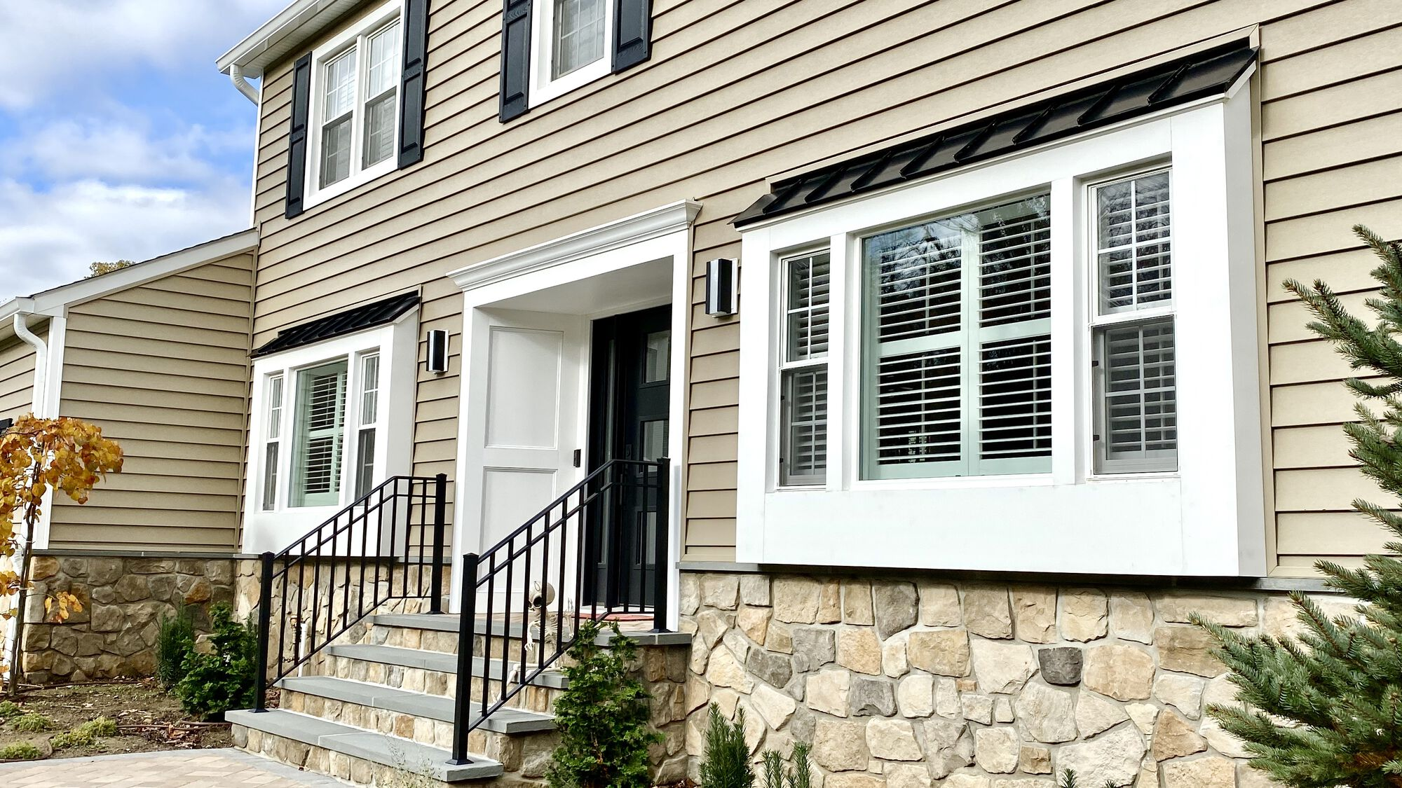 Prodigy Solid Backed Insulated Clapboard Siding, Azek Door Trim, Boral Cultured Stone, Metal Roofing, Thermopane Mezzo Windows in Randolph, Morris County NJ