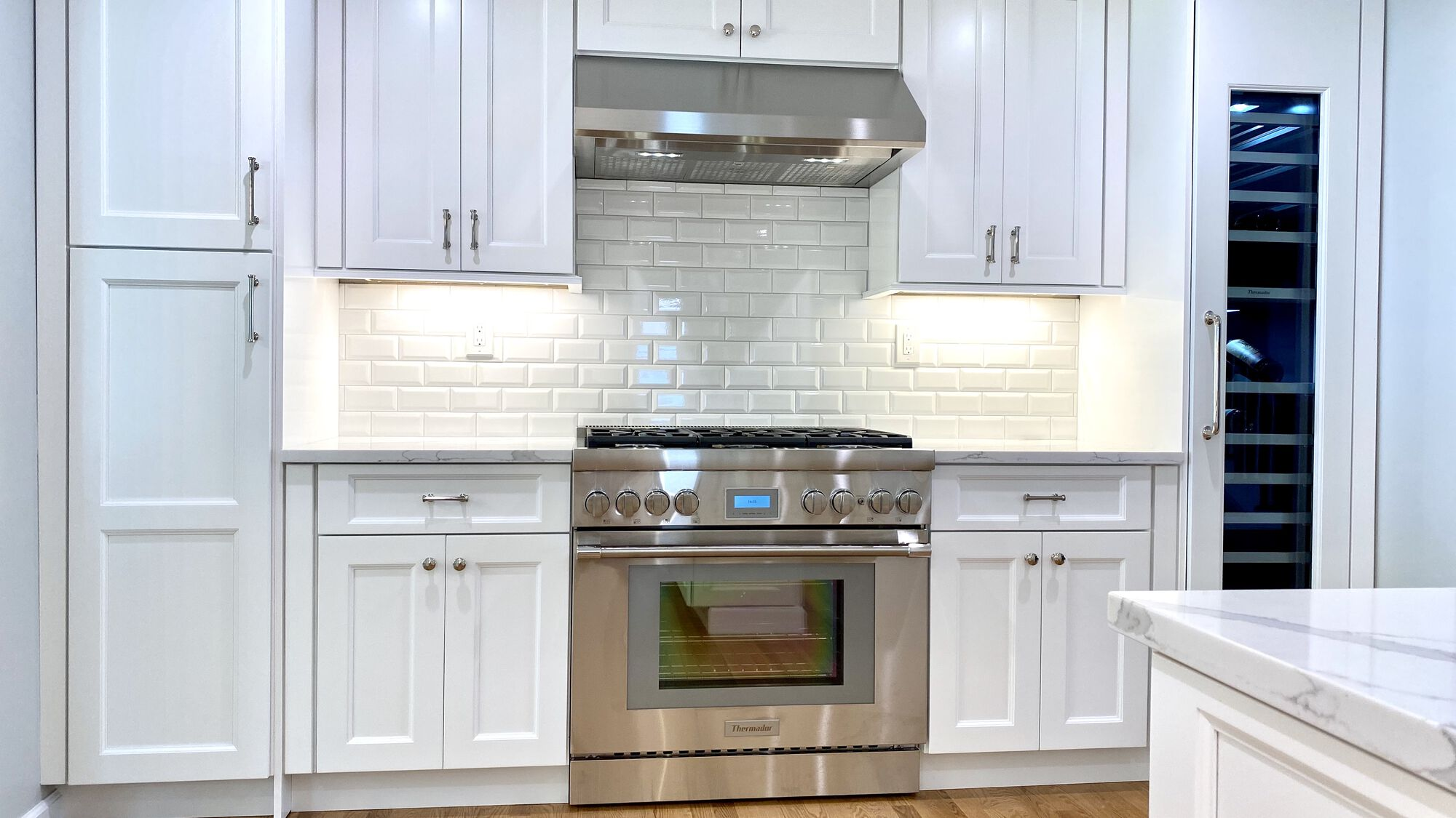 Kitchen with Shaker Cabinets, Thermador Appliances, Stone Countertops, Subway Tile Backsplash and Wood Floors in Cranford, Union County NJ