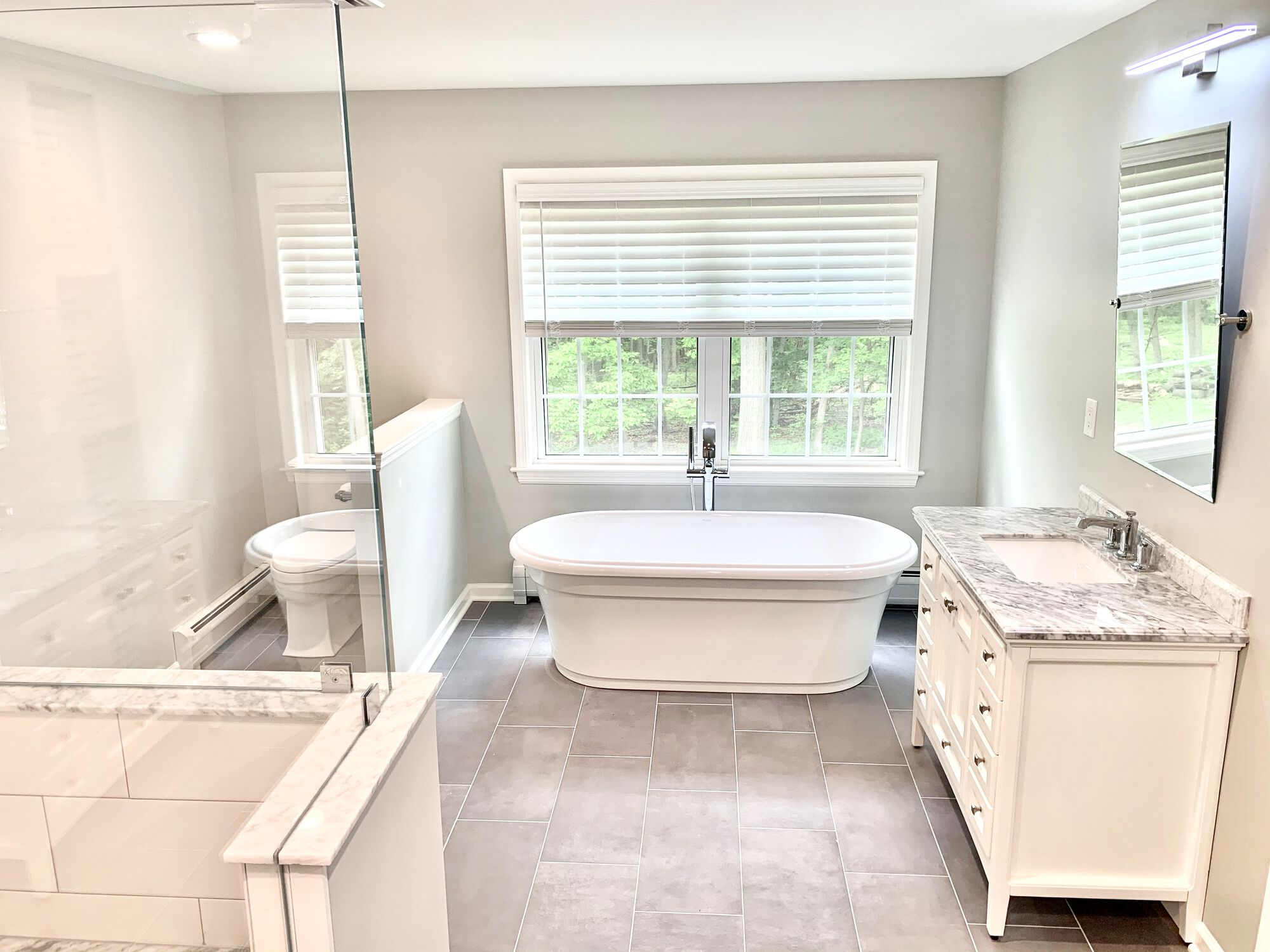 Master Bath in North Jersey with Kohler Fixtures, Ceramic Tile Flooring, Wood Cabinetry with Undermount Sink