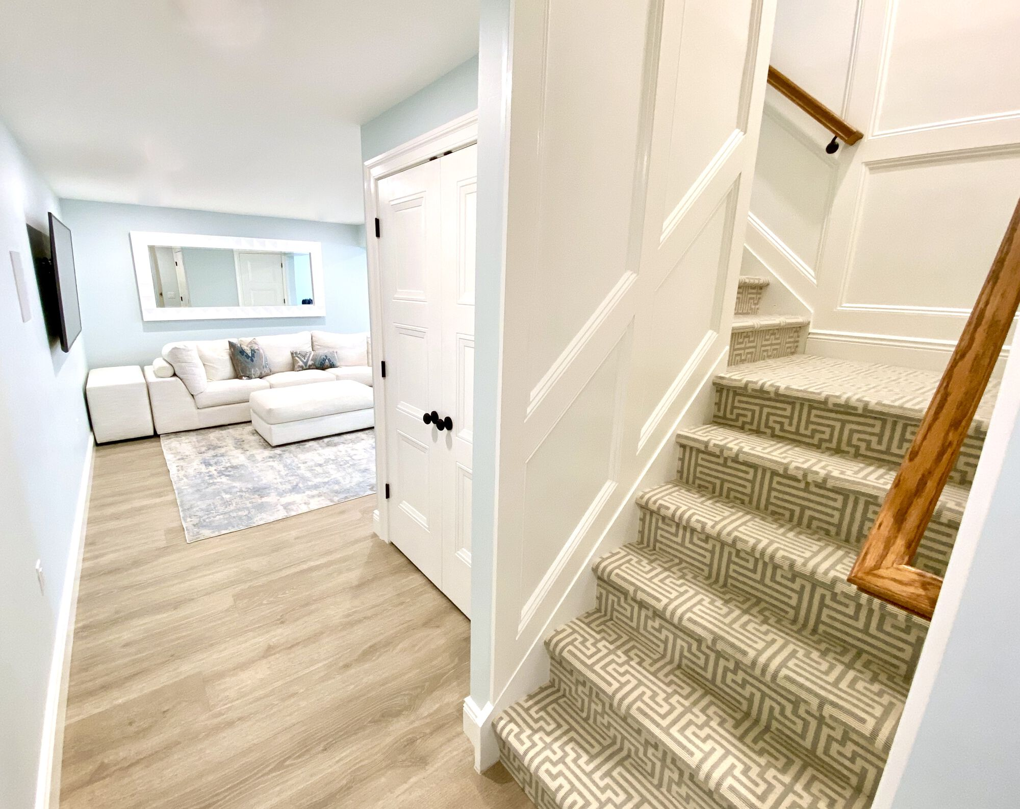 Basement Remodeling with Steel Beam Install ed to Remove a Column, Custom Trim and Paneling, Luxury Vinyl Plank Flooring, LED Lighting, Laundry _ Full Bath in Sparta, Sussex County NJ