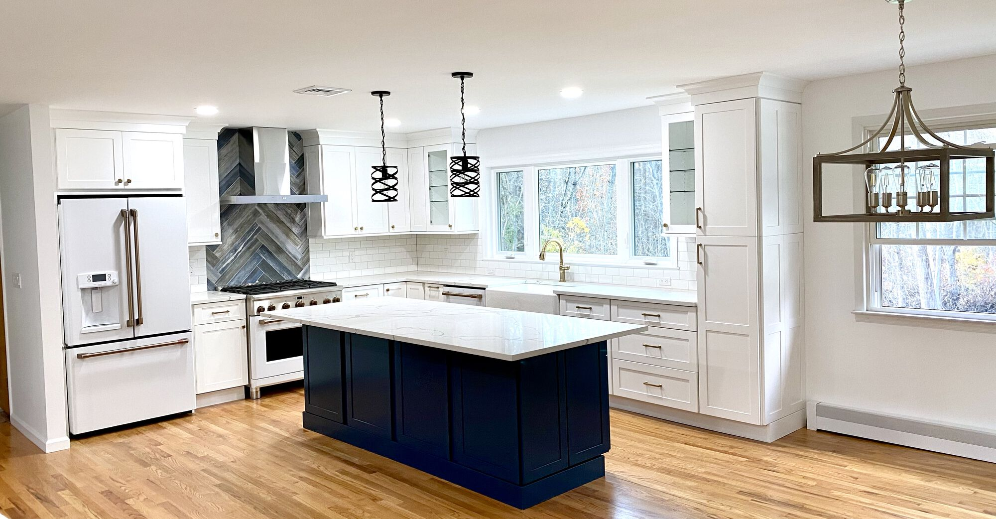 Open Concept Kitchen Remodeling with Wood Cabinetry, Custom Island, Quartz Tops, Harwood Flooring, New Thermopane Windows, GE Cafe Series in Berkeley Heights NJ