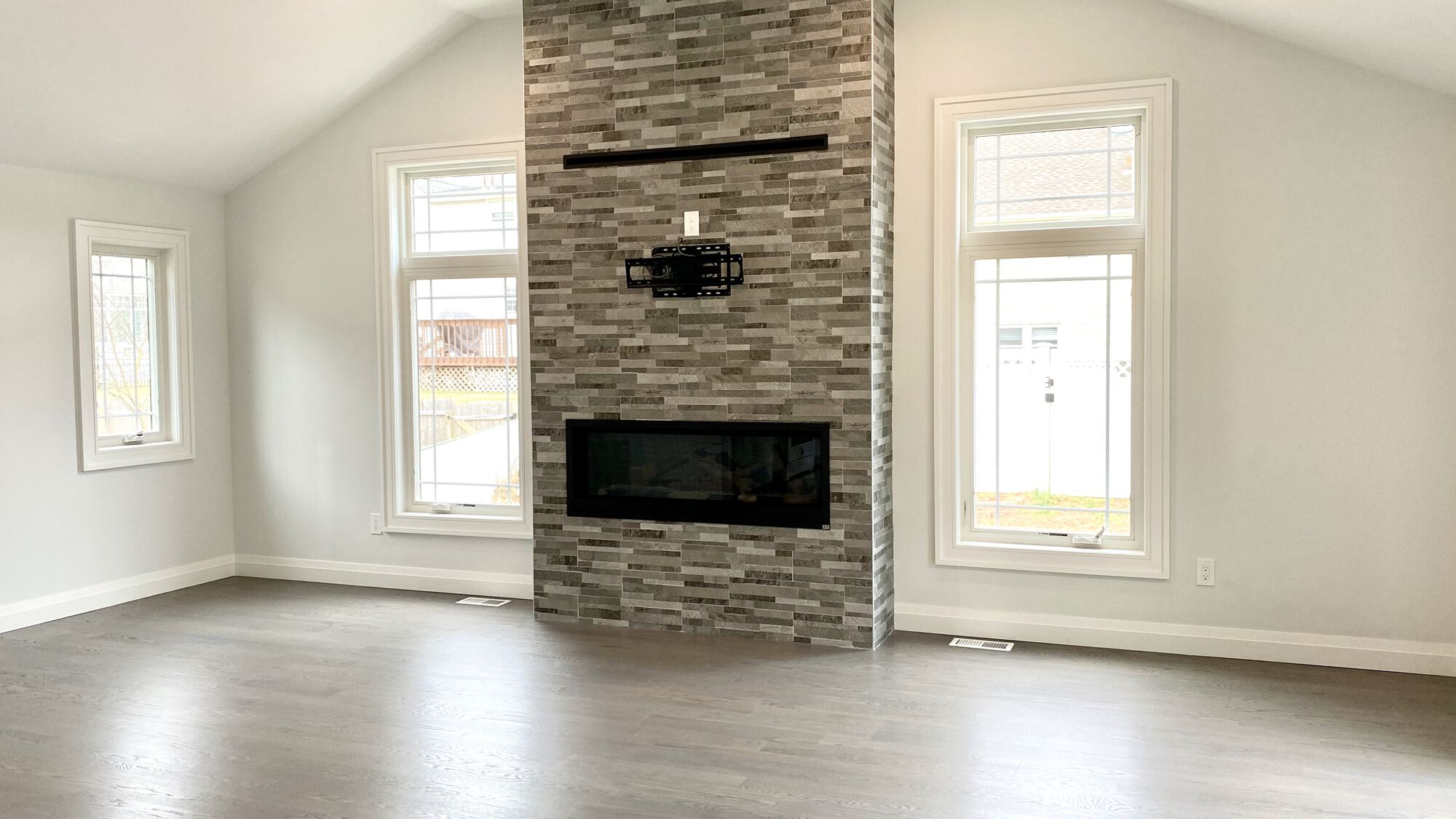 Family Room Addition with Vaulted Ceilings, Wood Flooring, Stone Fireplace, Andersen Windows and Patio Doors in Cranford, Union County NJ
