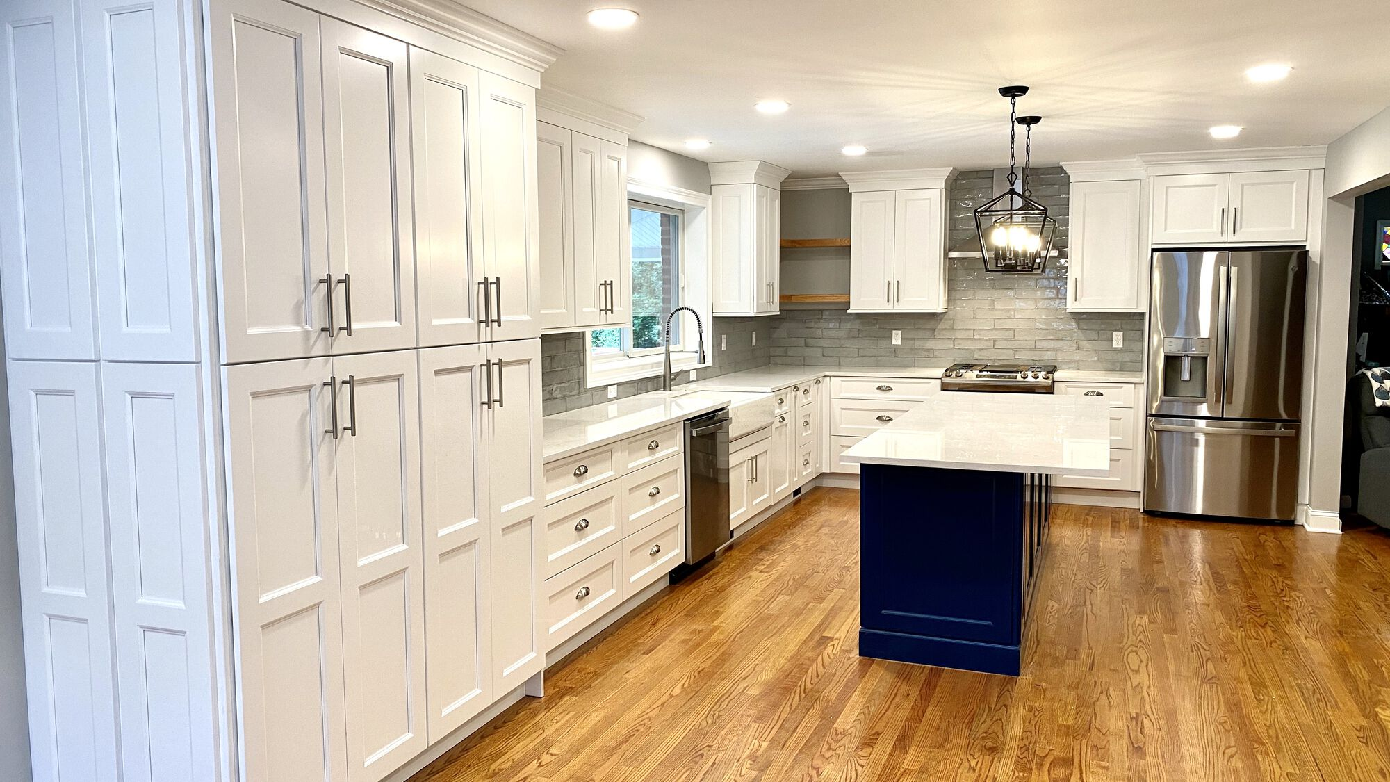 Kitchen Remodeling including Removing Wall Partitions, Oak Flooring, New Window Openings, Fabuwood cabinets, Quartz Tops, Andersen Windows in Bloomfield, Essex County NJ