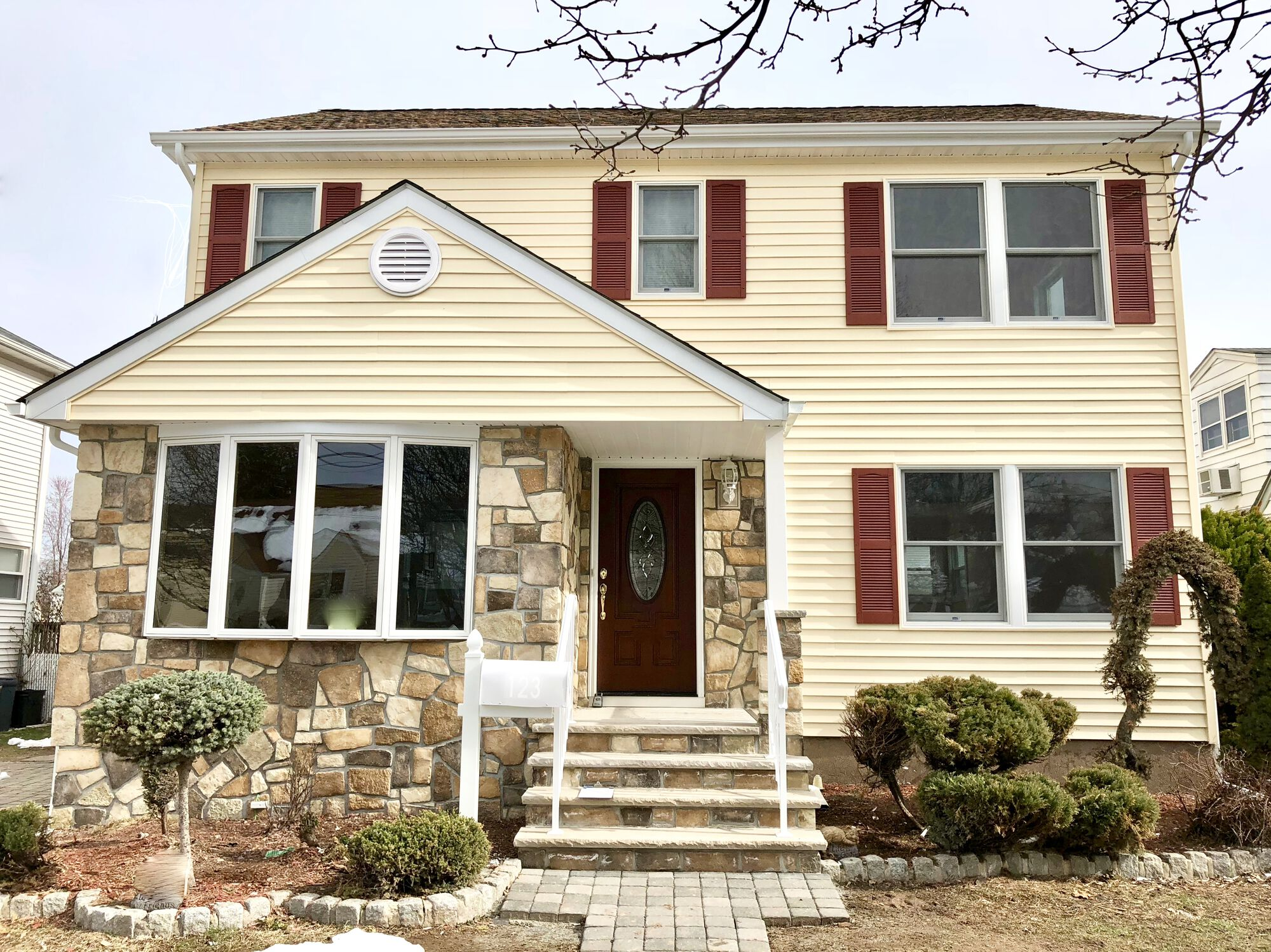 Add-a-Level Addition with Alside Siding, GAF Roofing, Andersen Windows, Boral Stone Front _ Steps, Timbertech Deck in Hasbrouck Heights, Bergen County NJ